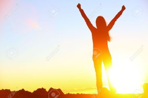 19557902-Happy-celebrating-winning-success-woman-at-sunset-or-sunrise-standing-elated-with-arms-raised-up-abo-Stock-Photo