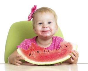 girl-eating-watermelon_157070413-300x244