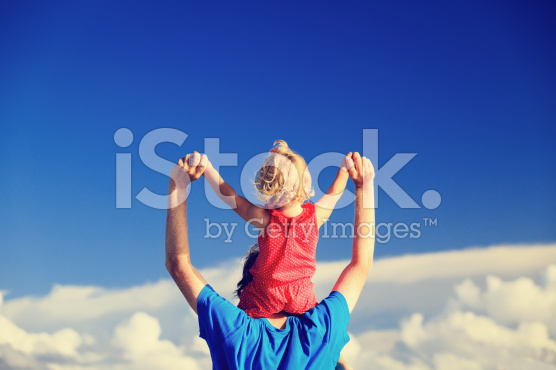 stock-photo-75334503-father-and-little-daughter-on-shoulders-play-at-sky
