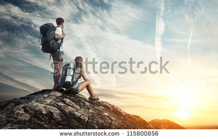 stock-photo-two-tourists-with-backpacks-enjoying-sunset-on-top-of-a-mountain-115800856