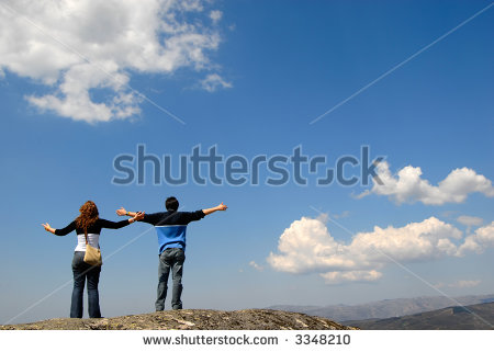 stock-photo-young-couple-in-the-top-of-the-mountain-3348210