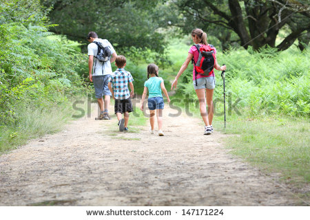 stock-photo-back-view-of-family-on-a-trekking-day-in-countryside-147171224