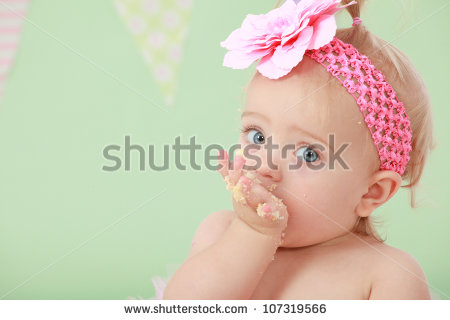 stock-photo-adorable-blond-hair-big-blue-eyed-baby-girl-with-pink-flower-elastic-head-band-on-head-and-pony-107319566