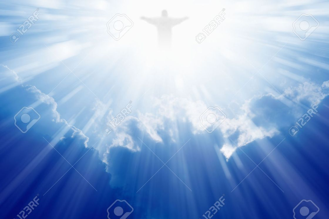 25445617-Bright-light-of-Jesus-Christ-in-blue-sky-with-clouds-Stock-Photo