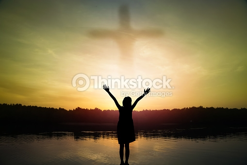 girl standing arms, out stretched at sunset